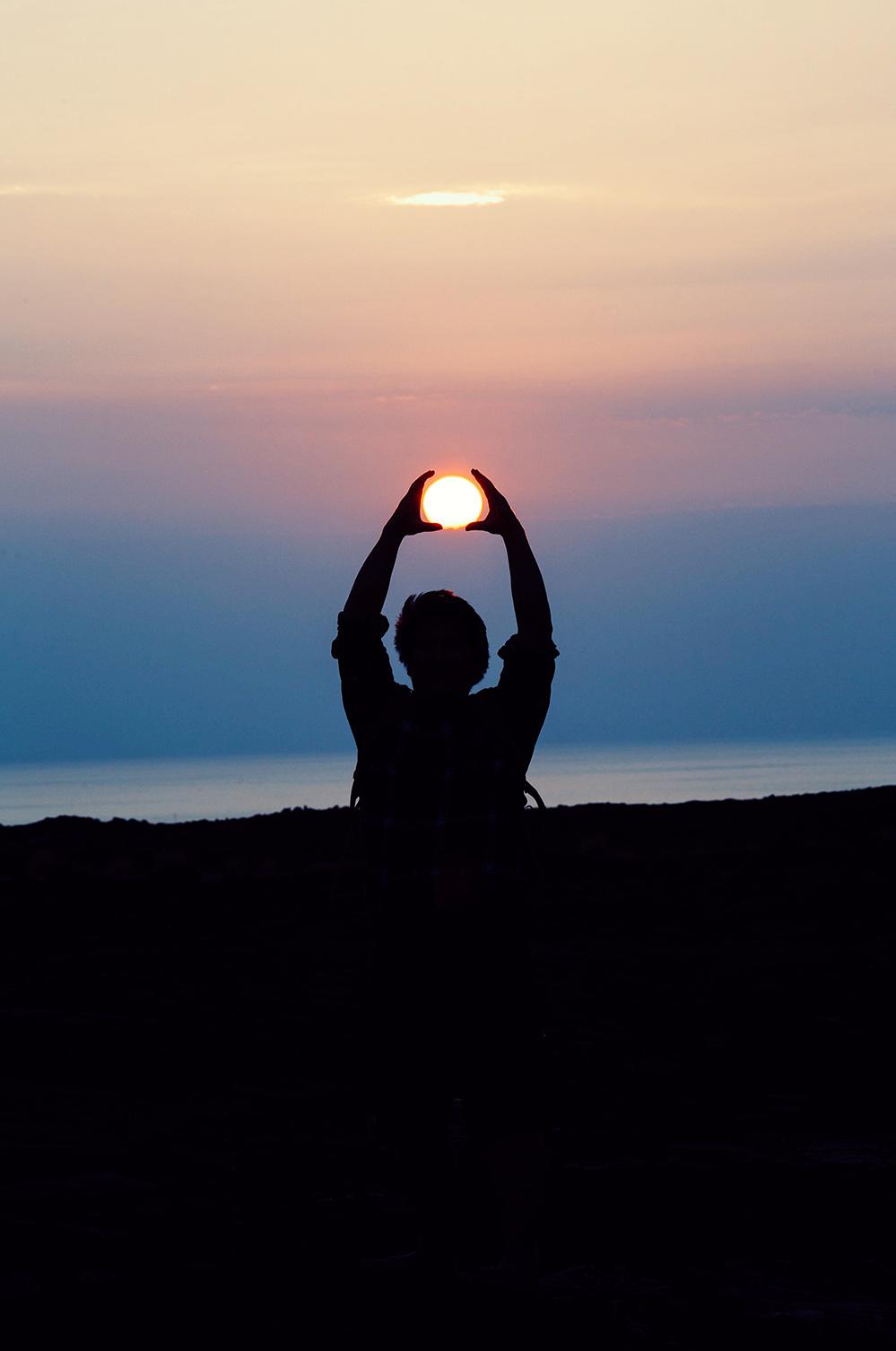 yoga sunset by Jason Leung